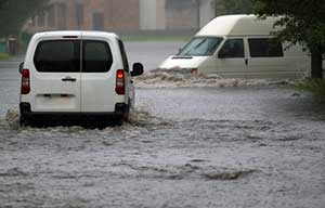 Commercial vehicles in the middle of a flood