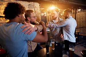 Fight about to breakout at a bar