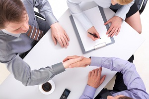 above view of businessmen doing agreement with woman near by
