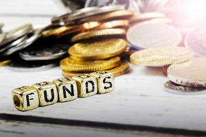 dice with word funds and coins on wooden background