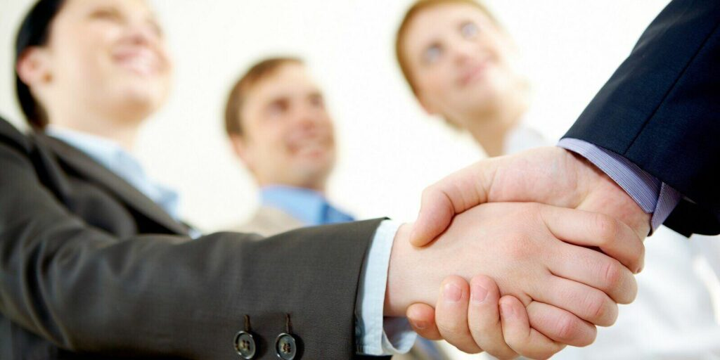 business partners handshake on signing contract