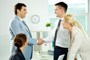 successful associates handshaking after striking deal for a trade associations