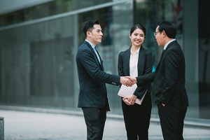 businessman handshake and deal business with professional employee for Umbrella insurance