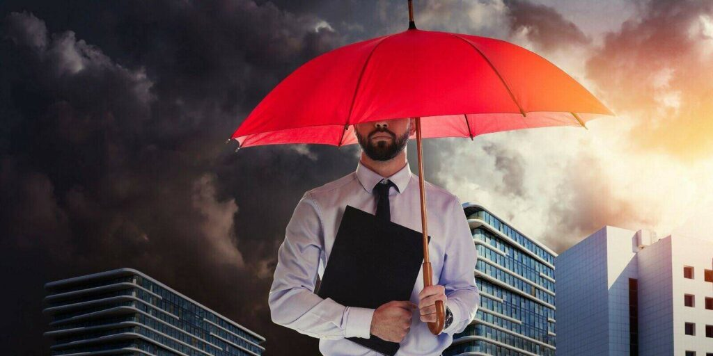 businessman with umbrella in city center