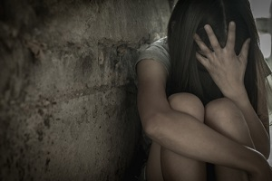 women sit sad because of being tempted and needs abuse and molestation insurance