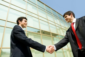 business men shaking hands after a deal for Insurance For Trade Associations
