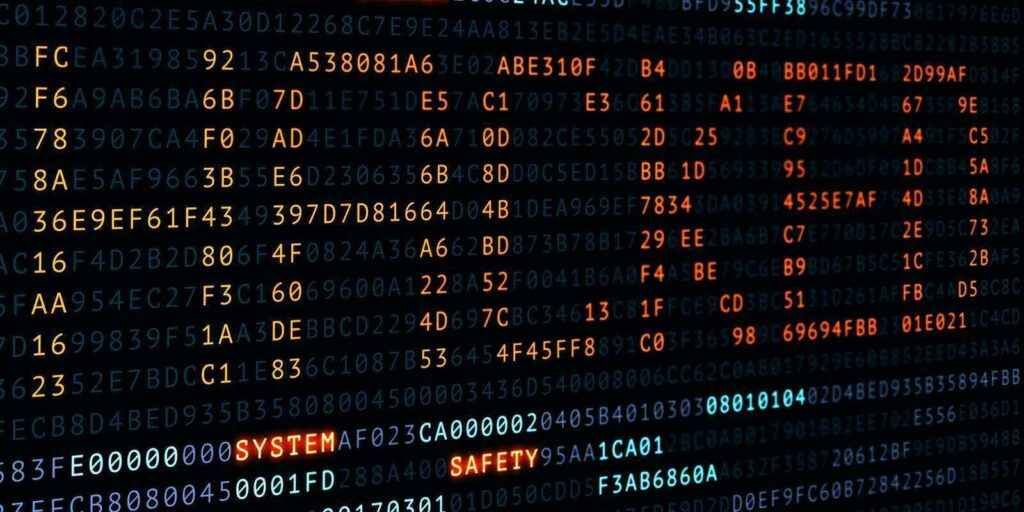 cyber attack hacked word on screen binary code display