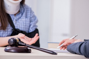 injured employee visiting lawyer for advice on third-party liability claims