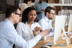 multiracial millennial people sitting in modern coworking office having third-party liability claims
