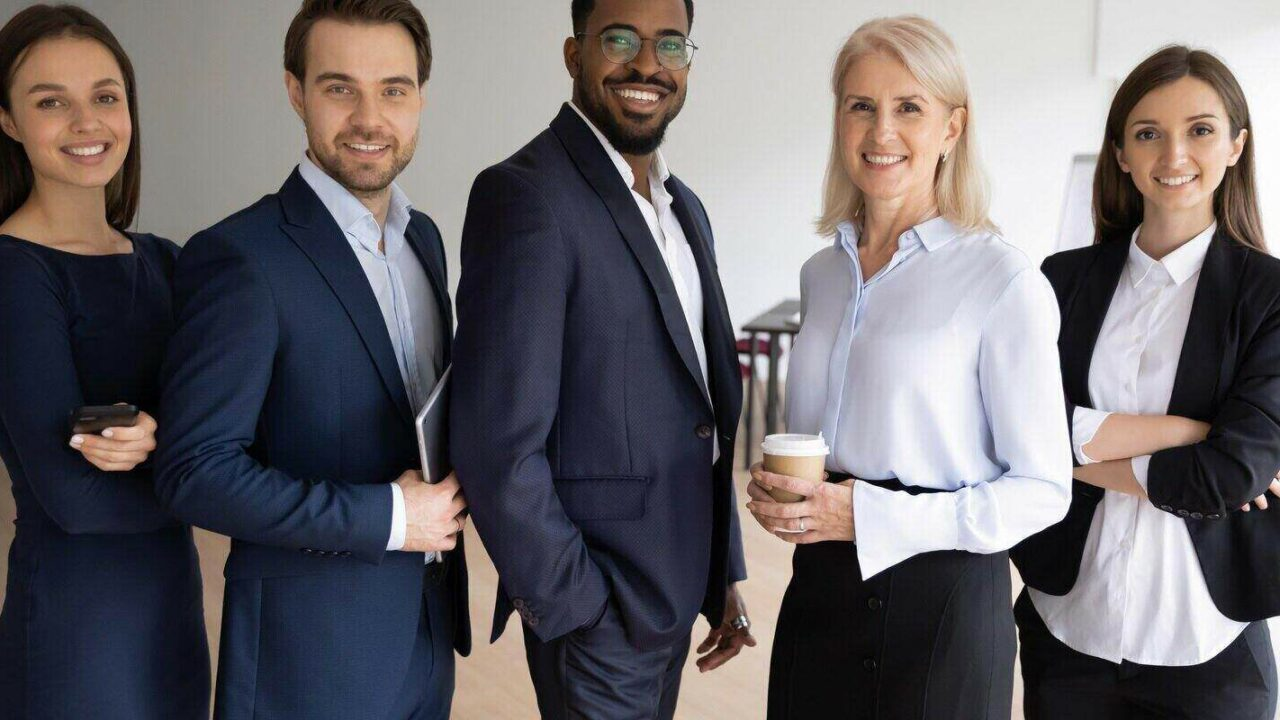 portrait of smiling successful multiracial international businesspeople
